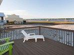 Lounge chair on open deck overlooking lagoon