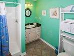 Loft bath with tile floor, single vanity and walk-in shower
