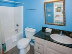 Master bath with tile floor, single vanity and tub/shower