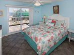 Master bedroom with tile floors and queen bed