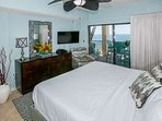 Master bedroom with 38-inch flat screen TV and seating area