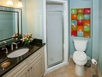 King ensuite bath with single vanity and walk-in shower