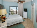 Guest room with queen bed and balcony access