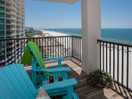 Adirondack chairs on tiled private balcony