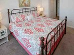 King bedroom with iron bed