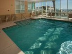 Indoor/outdoor pool overlooking beach and Gulf