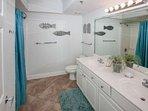 Master bath with dual vanities and tile floor