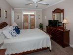 Second floor queen carpeted master bedroom with flat screen TV/DVD, private balcony access and seating area.