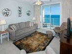 Tiled living room with ceiling fan and nautical decor