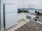 Fully equipped kitchen with granite counters, blender, coffee pot, toaster and electric can opener