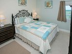 Tiled guest room with queen bed