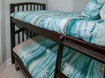 Cozy guest room with twin bunks