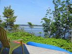 Enjoy the view of the inner bay from the deck of Ragged Island Retreat