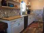 Kitchen with carefully selected Mexican style tile, ample dishes and cooking utensils.