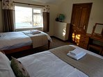 The twin room is also light and spacious  and has views of open countryside.
