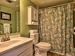 The private master bathroom features handicap friendly handrails.
