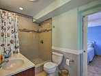 The walk-in shower is both elegant and huge.