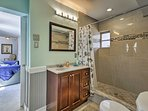 Close the barn door and enjoy some privacy in the spacious bathroom.