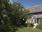 BROOK COTTAGE, pretty thatched cottage with wood burning stove in village locati