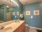 Double-wide mirrors complete the long vanity in this 2nd en-suite bathroom.