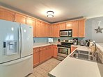 The fully equipped kitchen features ample counter space for food prep needs.