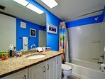 Bright beach colors in the guest bathroom.