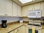 kitchen has granite counter tops.