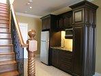 Kitchenette, full sized fridge/freezer; microwave, sink