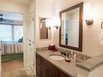 Private master bathroom with large walk in shower.
