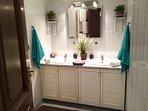 Large bathroom with bathtub, shower and a bidet