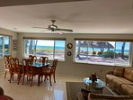 Dining area in Florida Room overlooking the TIKI Hut and the beach.