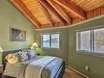 Enjoy lake views from this tastefully appointed bedroom.