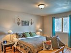 The master bedroom boasts a plush king bed.