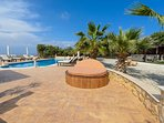Relax on one of many outdoor terraces with sea views; the new Cyprus Tennis Academy is only 600 metr
