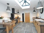 Kitchen with orangery style ceiling