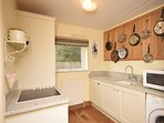 Utility room with oven,microwave and washing machine