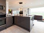 Spacious kitchen with bi-folding doors onto the balcony