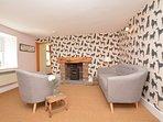 Enjoy the wood burner in the stylish snug lounge
