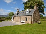 View towards this charming cottage with fully enclosed gardens and views over the Cairngorms