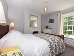 Beautiful double bedroom with views onto the green