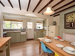 Warm and inviting kitchen/diner, bathed in light