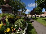 The village green looking towards the lovely cafes and shops