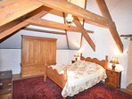 Double bedroom with exposed beams