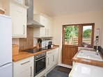 Kitchen with stable style door leading out into the garden