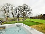 Relax in the hot tub and enjoy the country views from the enclosed garden