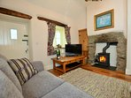 Relax in the lounge by the wood burner