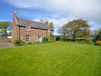 View toward the charming period cottage with fully enclosed garden