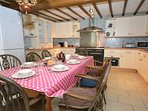 Farmhouse style kitchen/dining room with access to patio