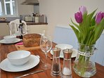 Stylish kitchen/diner ideal for preparing a family meal