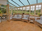 Spacious conservatory leading to the veranda
